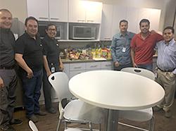 Ciena volunteers standing in breakroom